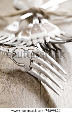 Antique forks at close up - very shallow depth of field - stock photo