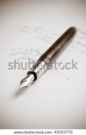 Antique Fountain Pen with Obscured Writing - stock photo