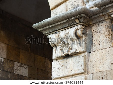 Antique fragment in a medieval roman building. Spain. - stock photo