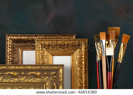 antique frame and paintbrushes - stock photo