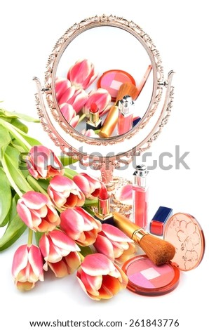Antique gilded mirror, cosmetics for women's makeup and tulip flowers on a white background - stock photo