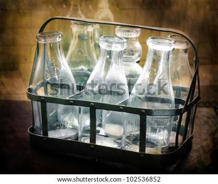 Antique glass milk bottles - stock photo