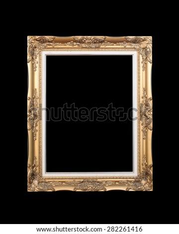 Antique gold frame isolated on black background - stock photo