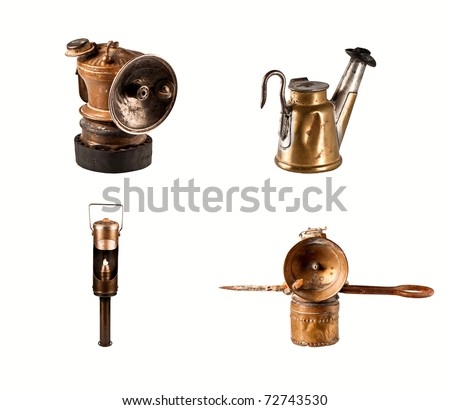 Antique gold miner's lamps isolated on white. - stock photo