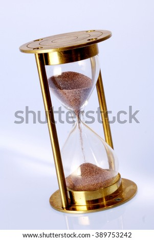 Antique hourglass on white background