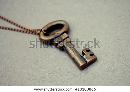 antique key  vintage wooden background - stock photo