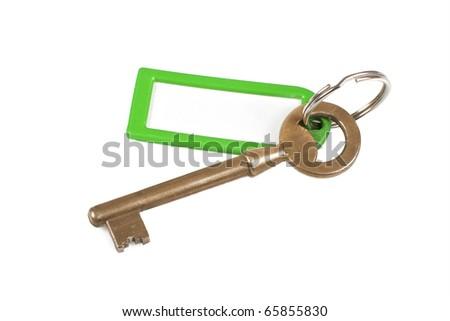 antique key with empty label - stock photo