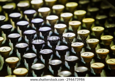 Antique keyboard of science and evolution on background. - stock photo