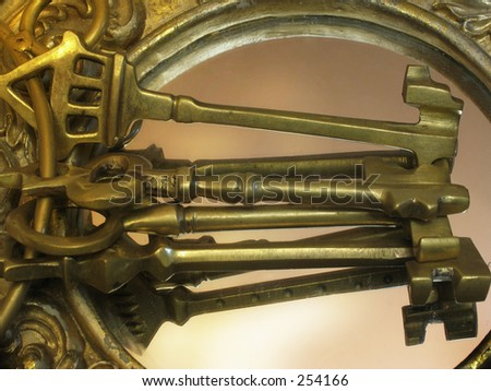 Antique keys reflected on a mirror with dramatic lighting