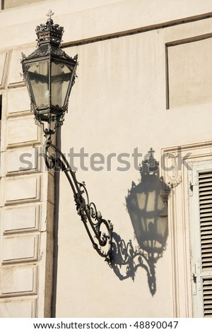 antique lamp on side of Royal Palace in Turin - Italy