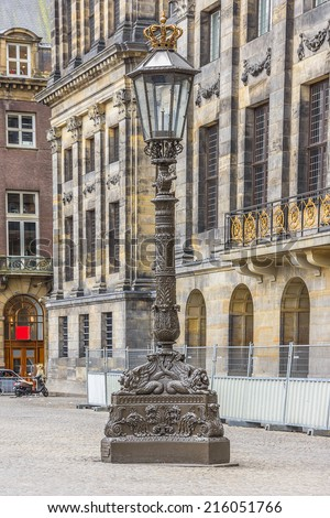 Antique Lamp Post near Royal Palace (Koninklijk Paleis) at the Dam Square in Amsterdam, Netherlands. - stock photo