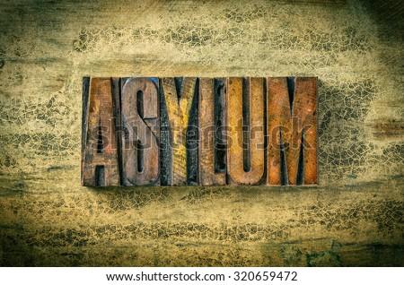 Antique letterpress wood type printing blocks - Asylum - stock photo