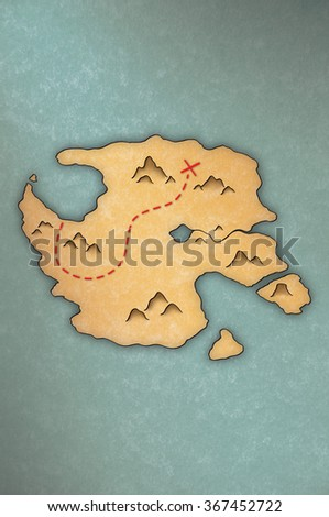Antique-looking treasure map of an island on papyrus-like paper - stock photo