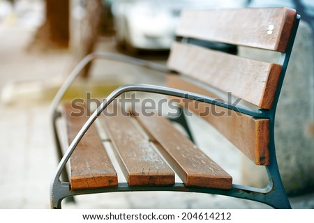 Antique metal bench on the park. vintage color toned image - stock photo