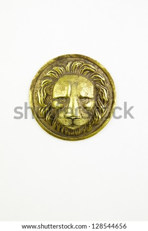 Antique metallic head of  lion isolated background - stock photo
