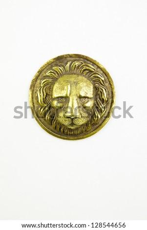 Antique metallic head of  lion isolated background - stock photo