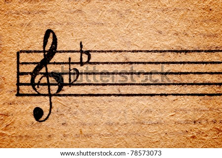 antique music sheet with grungy texture - stock photo
