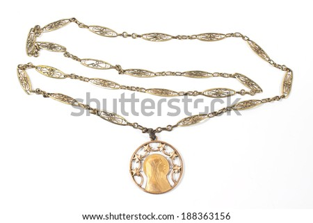 Antique necklace with Virgin Mary pendant isolated on white