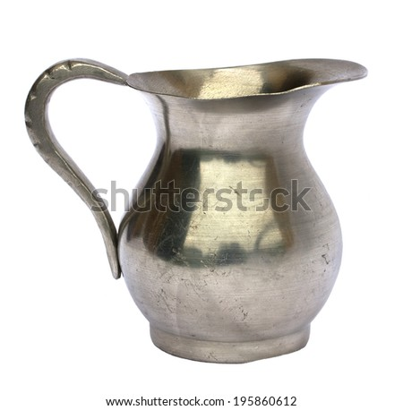 Antique old pewter pitcher isolated on white background - stock photo