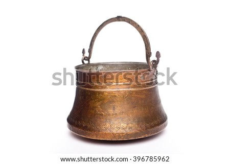 antique open brass pot close up isolated on white background - stock photo