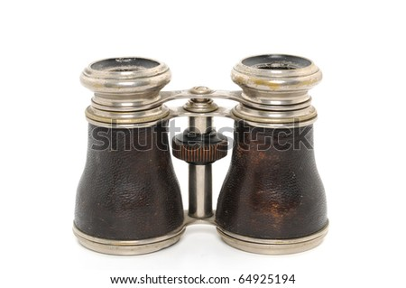 Antique opera binoculars in front of a white background