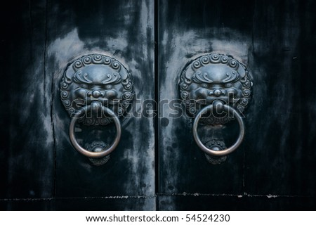 antique oriental door knocker - stock photo