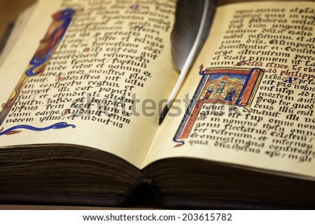 Antique paper book open pages with ancient text letters and ink writing quill pen - stock photo