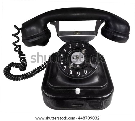 Antique phone isolated on white - stock photo