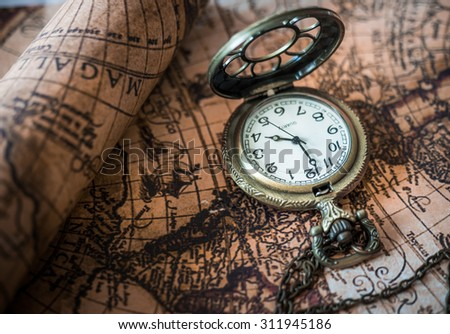 Antique Pocket Watch Clock On A Vintage Map.