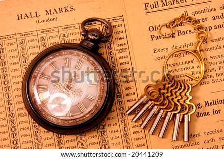 Antique pocket watch with watch keys. - stock photo