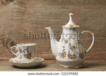 Antique porcelain tea and coffee set  on a wooden background