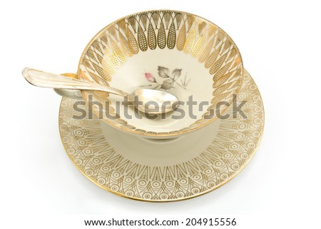 Antique porcelain tea cup isolated on white - stock photo