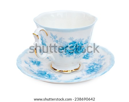 Antique porcelain tea cup & saucers with floral painting on white background