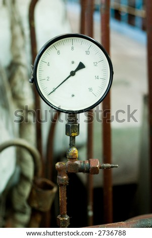 antique pressure control device on the rusty pipe