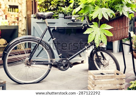 Antique push bike with advertising space sign for an plants shop - stock photo