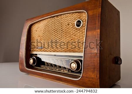 antique radio on vintage background. - stock photo