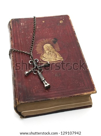 Antique red bible with unique nail cross, isolated on white background - stock photo