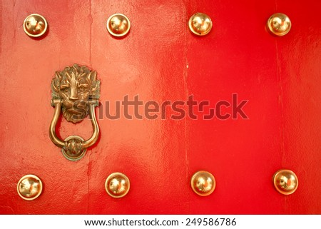 Antique Red Chinese door with knocker - stock photo