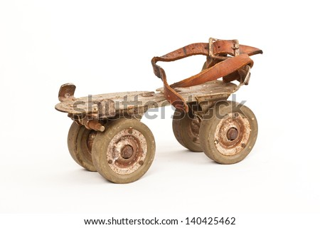 antique roller skate isolated on white - stock photo