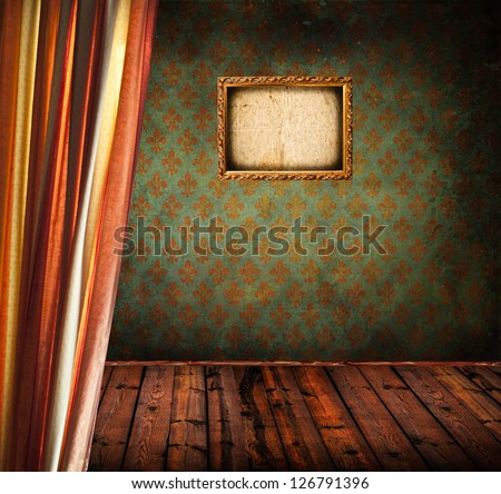 Antique room with grunge wall and empty photo frame - stock photo