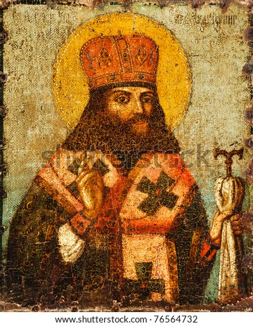 Antique Russian orthodox icon with saint painted on wooden board. - stock photo