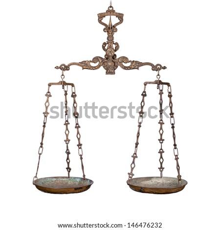 Antique rusty balance scale isolated on white - stock photo