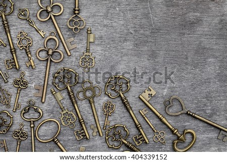 Antique rusty key on grunge wood background, copy space - stock photo