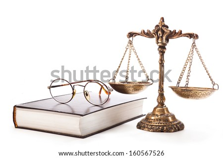 Antique scales, glasses with a book on white background - stock photo