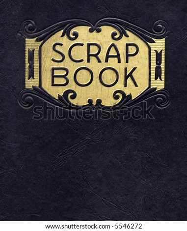 Antique scrapbook, circa 1890, with black cover and gold leaf printing. - stock photo