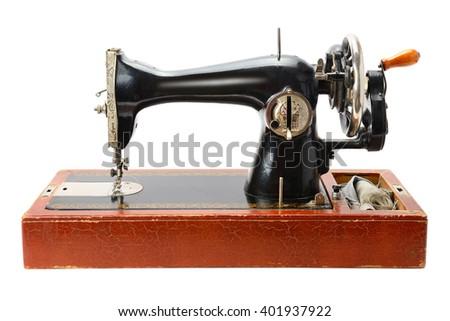 Antique sewing machine isolated on white background - stock photo