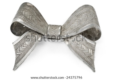 Antique silver bow pin - stock photo