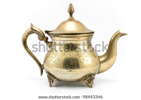 Antique silver teapot isolated on white