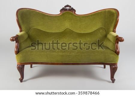 Antique sofa, studio shot with shadows.Photo taken on: December 17th, 2015 - stock photo