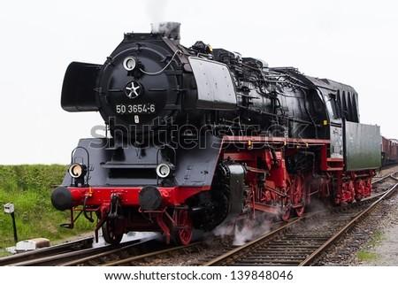 Antique steam locomotive - stock photo